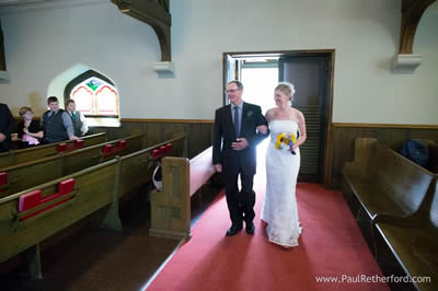 Father escorting bride at Little Stone Church